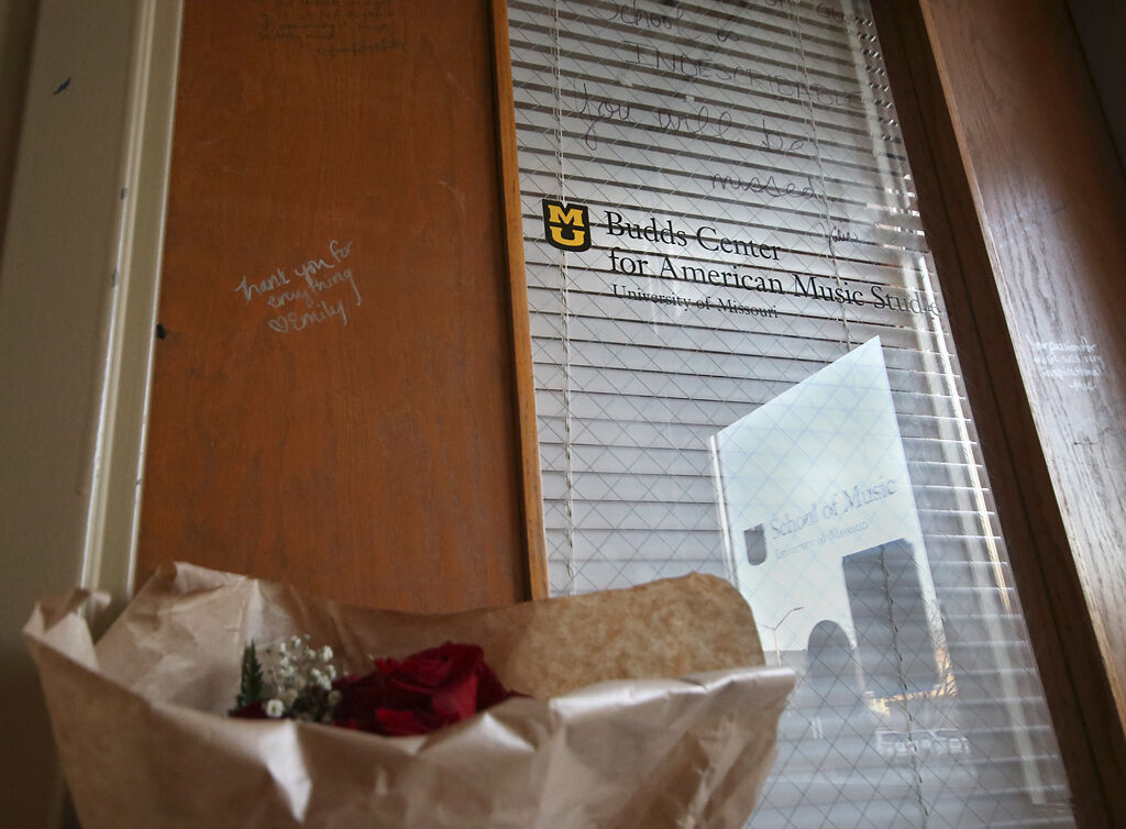 The door of the Budds Center for American Music Studies is decorated with flowers and notes from students and faculty after former music professor Micheal Budd's death