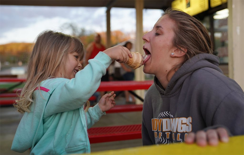 Lillie Risinger and Sarah Casebeer share ice cream at Jolly Cone Drive-In