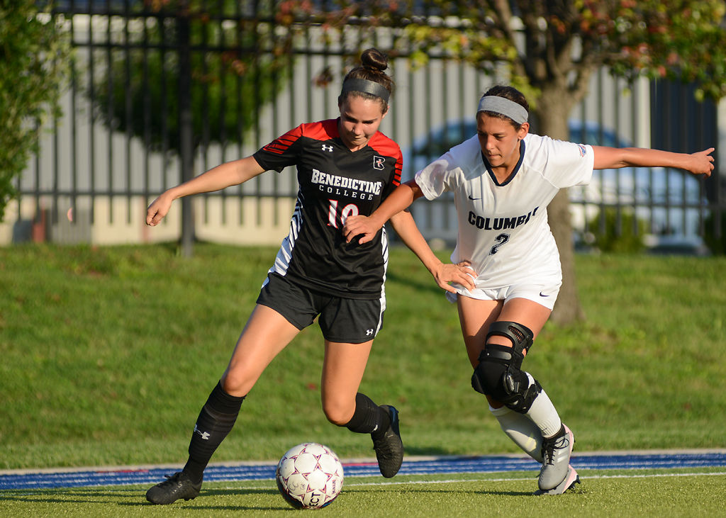 Sydney Routh and Elisa Vega fight for possession