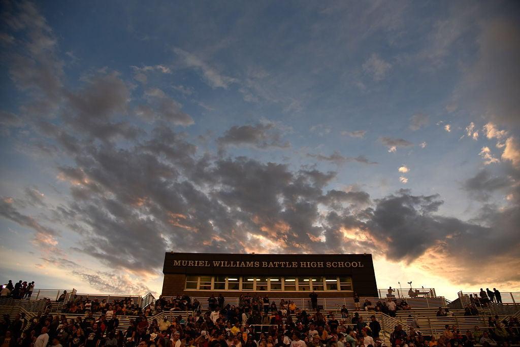 Fans of Muriel Battle High School's football team prepare for a football game