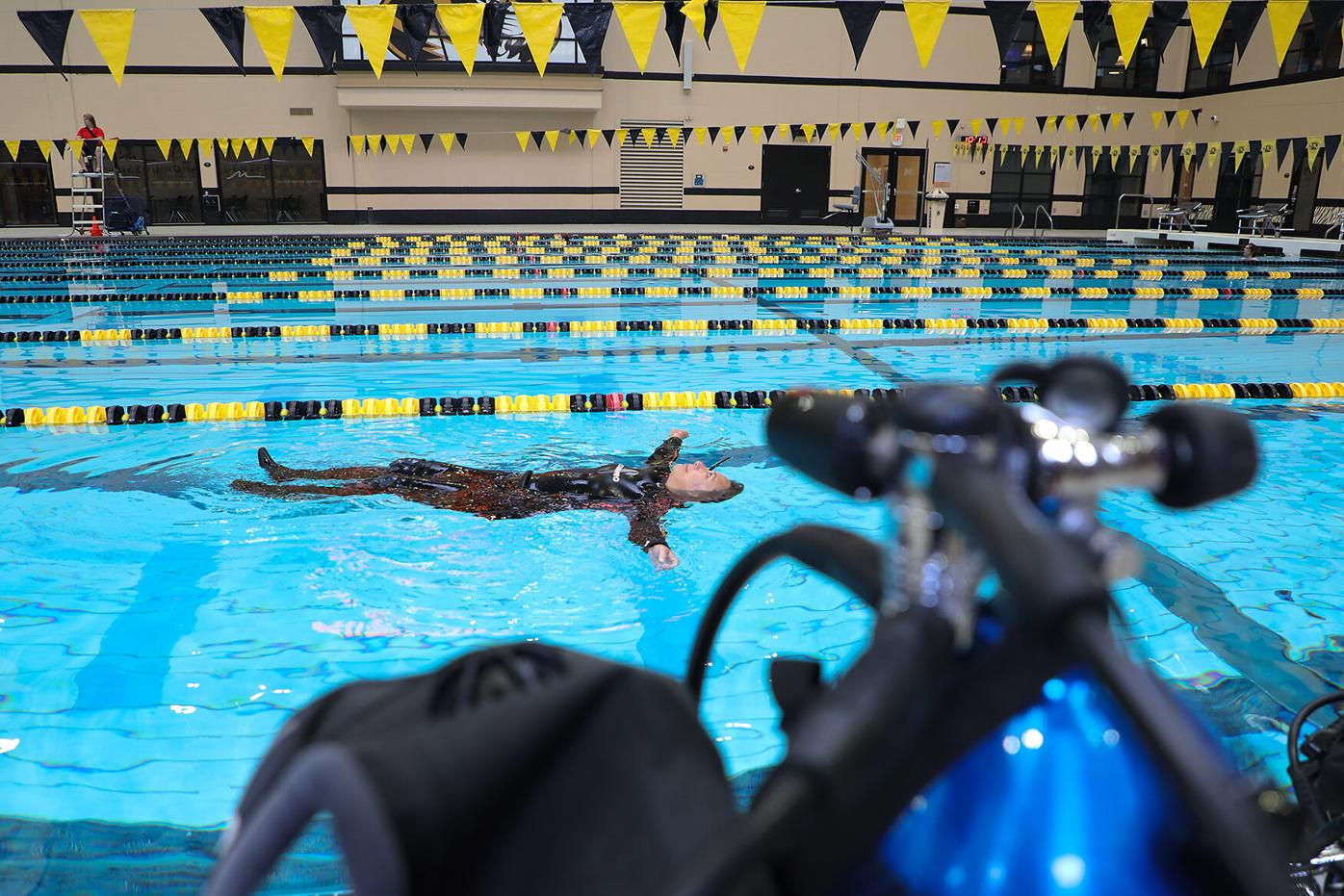 Columbia resident Tanya Haeussler checks her buoyancy before her final scuba diving class