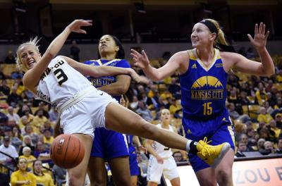 MU guard Sophie Cunningham tries to save a Missouri shot