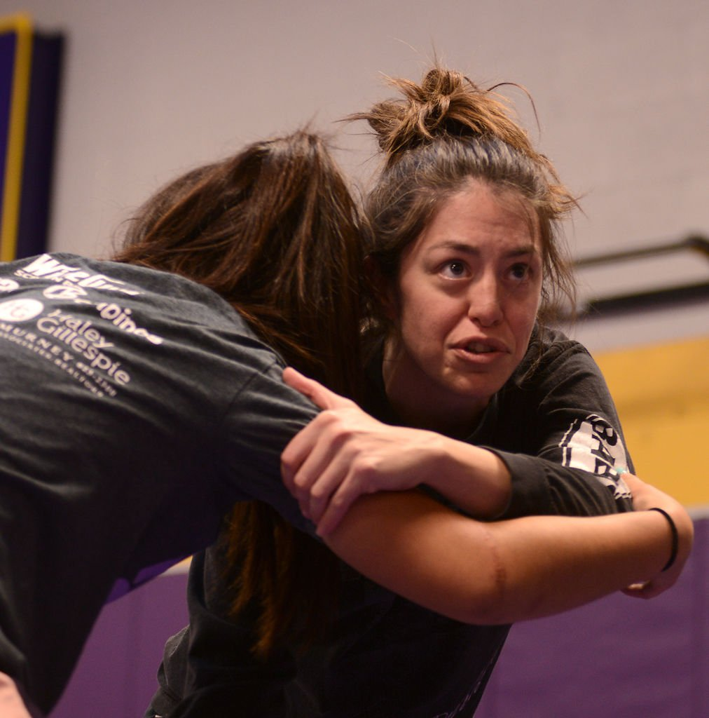 Coach Andrea Whitney demonstrates proper technique to novice wrestlers