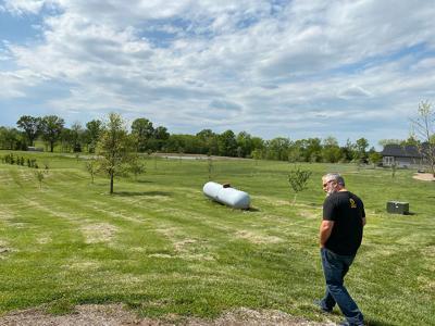 Tony Marrero walks through fields
