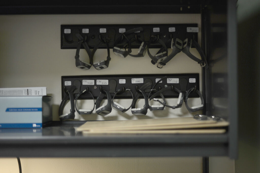 A set of sleep monitoring wristbands hang from their designated hooks on Monday Dec. 7, at the Missouri Psychiatric Center in Columbia.