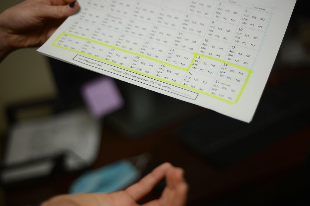 A researcher holds an alcohol tracker on Monday, Dec. 7, at the Missouri Psychiatric Center.