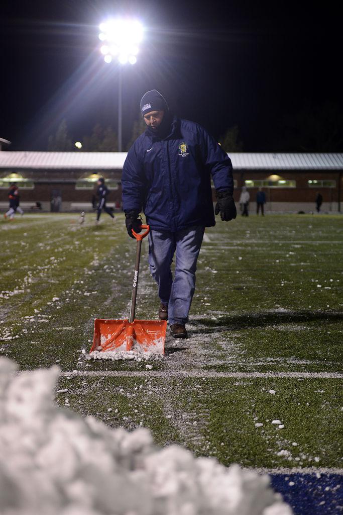 Gary Stanowski shovels the field