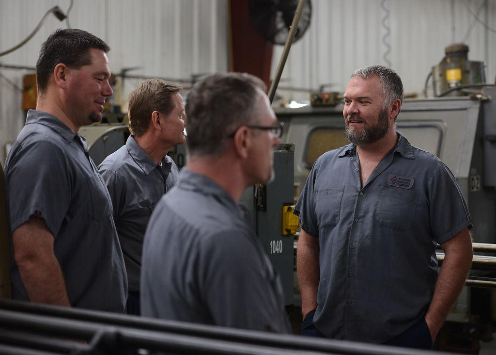 Economy Products Company workers wait on Missouri Governor Eric Greitens