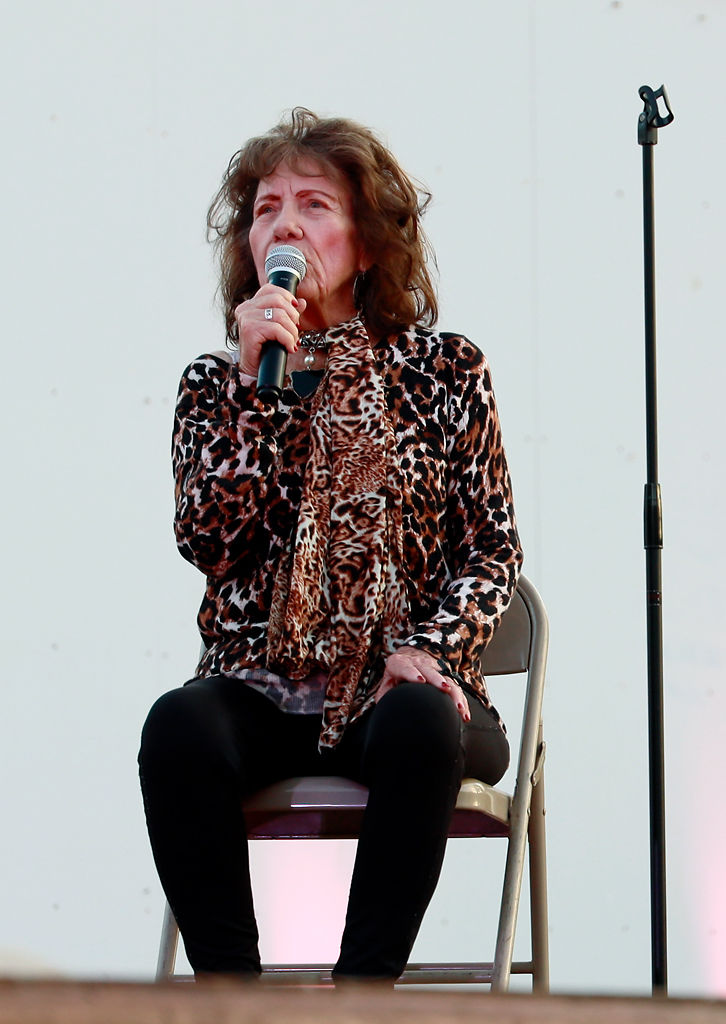 """Virginia Nowlin Draper sits to sing """"I fall to pieces"""" by Patsy Klien"""