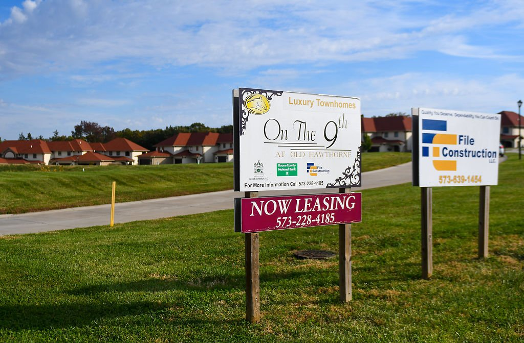 Leasing signs advertise the new luxury townhomes recently completed