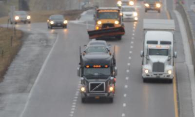 Trucks drive down I-70