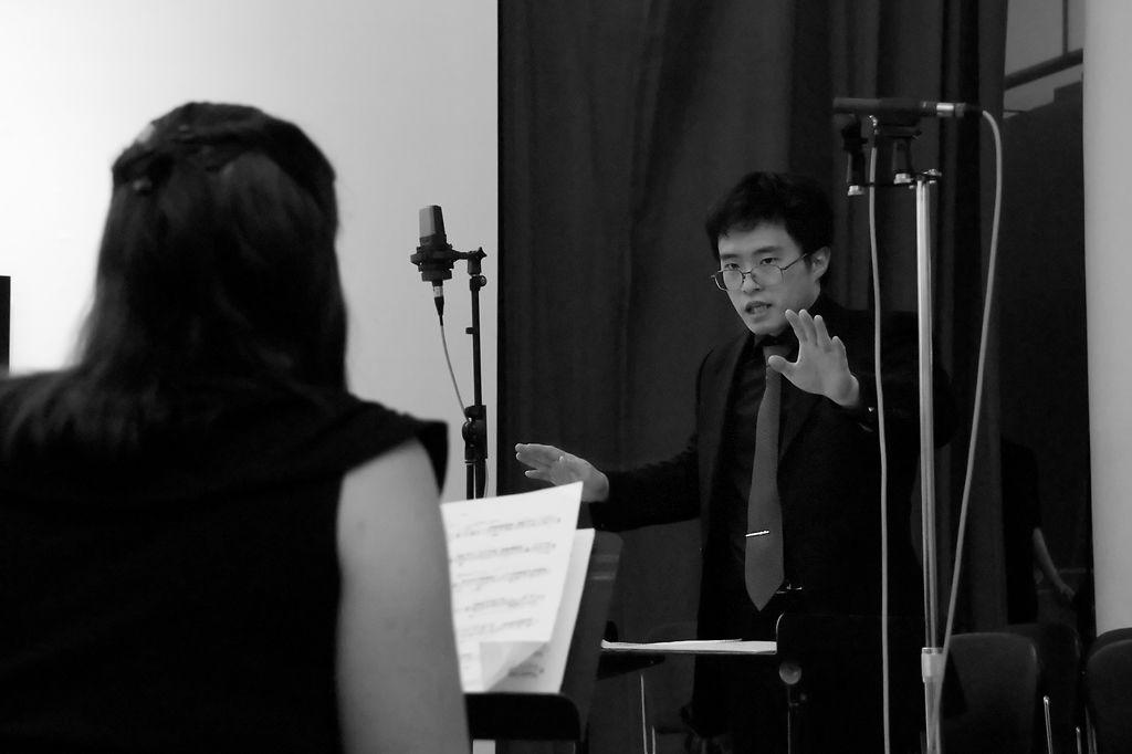 Yoshiaki Onishi conducts a small ensemble in 2012