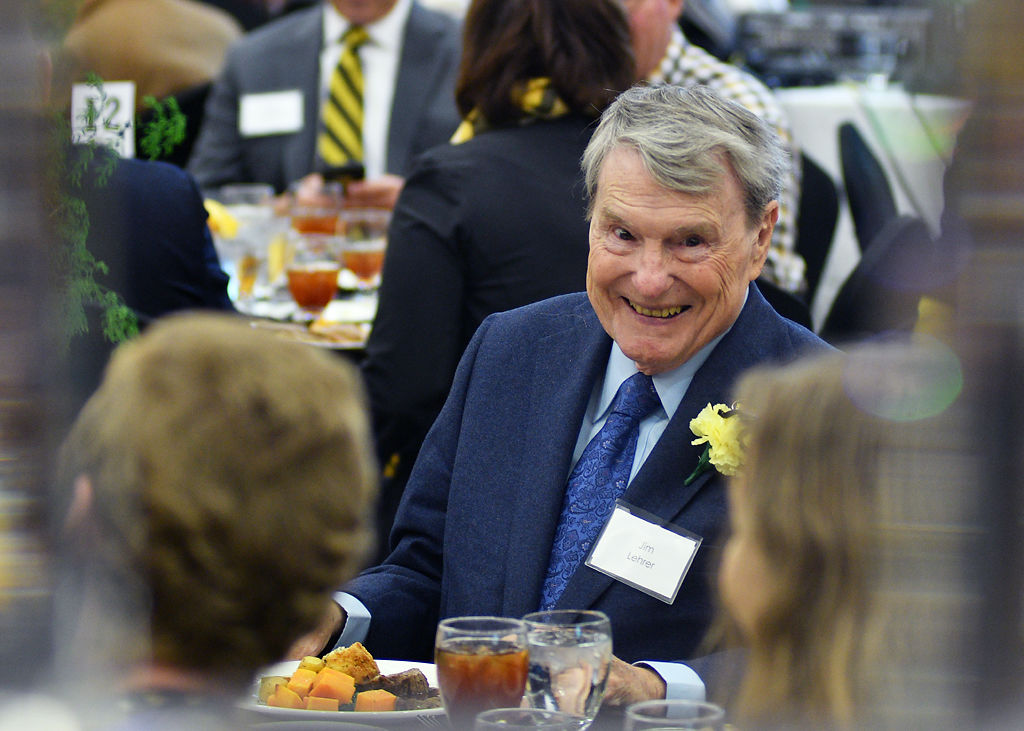 Jim Lehrer laughs with guests