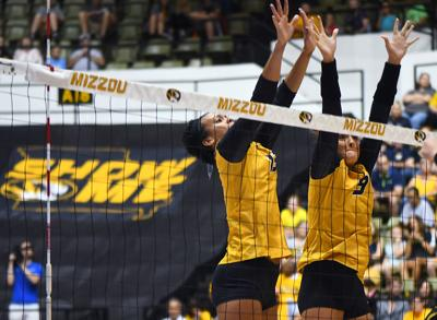 From Left, Dariana Hollingsworth-Santana and Tyanna Omazic attempt to block a ball (copy)