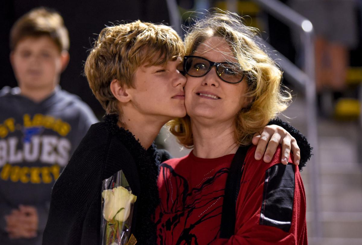 Jack Ewers, 13, leans on his mother Tam Ewers