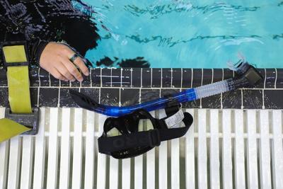 University of Missouri sophomore Savannah Pattridge sets down her dive mask after a scuba diving class