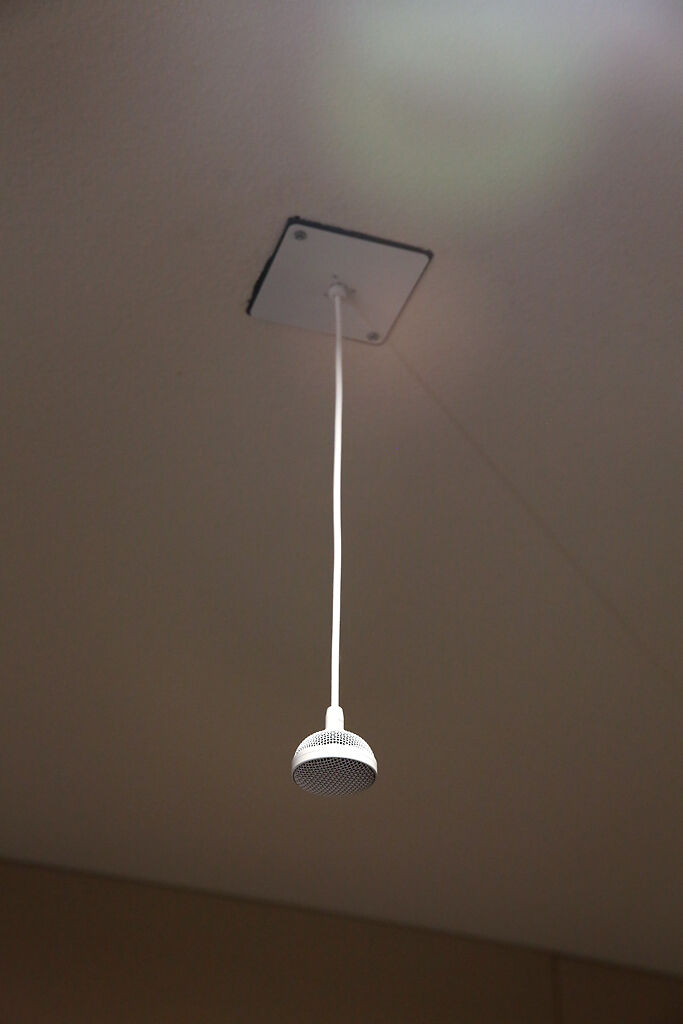 A microphone hangs from the ceiling