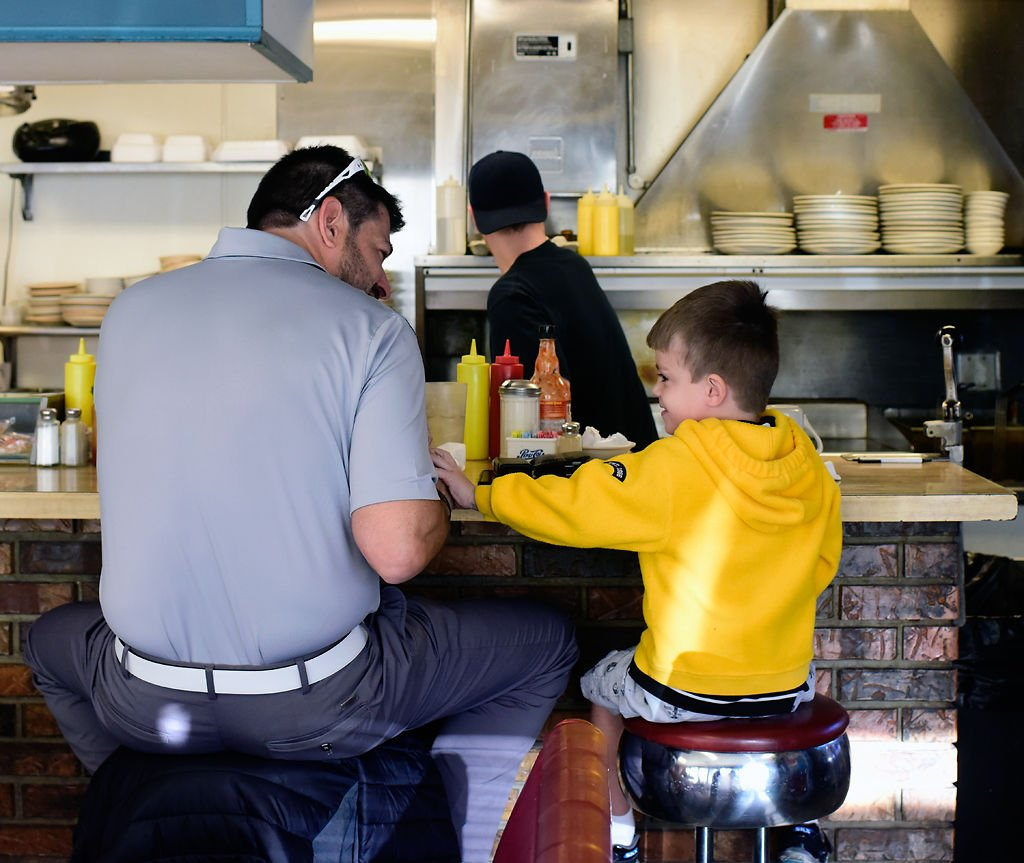 James 'Jay' Yeager eats breakfast with his son Maddox Yeager