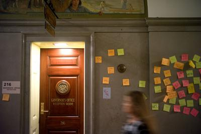 Paper notes stick to the walls near the entrance of the Missouri Governor's Office