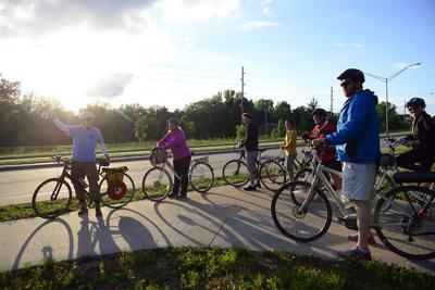 Bikers look towards Scott Blvd.