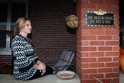 Heather Gieck poses in front of The Healing House