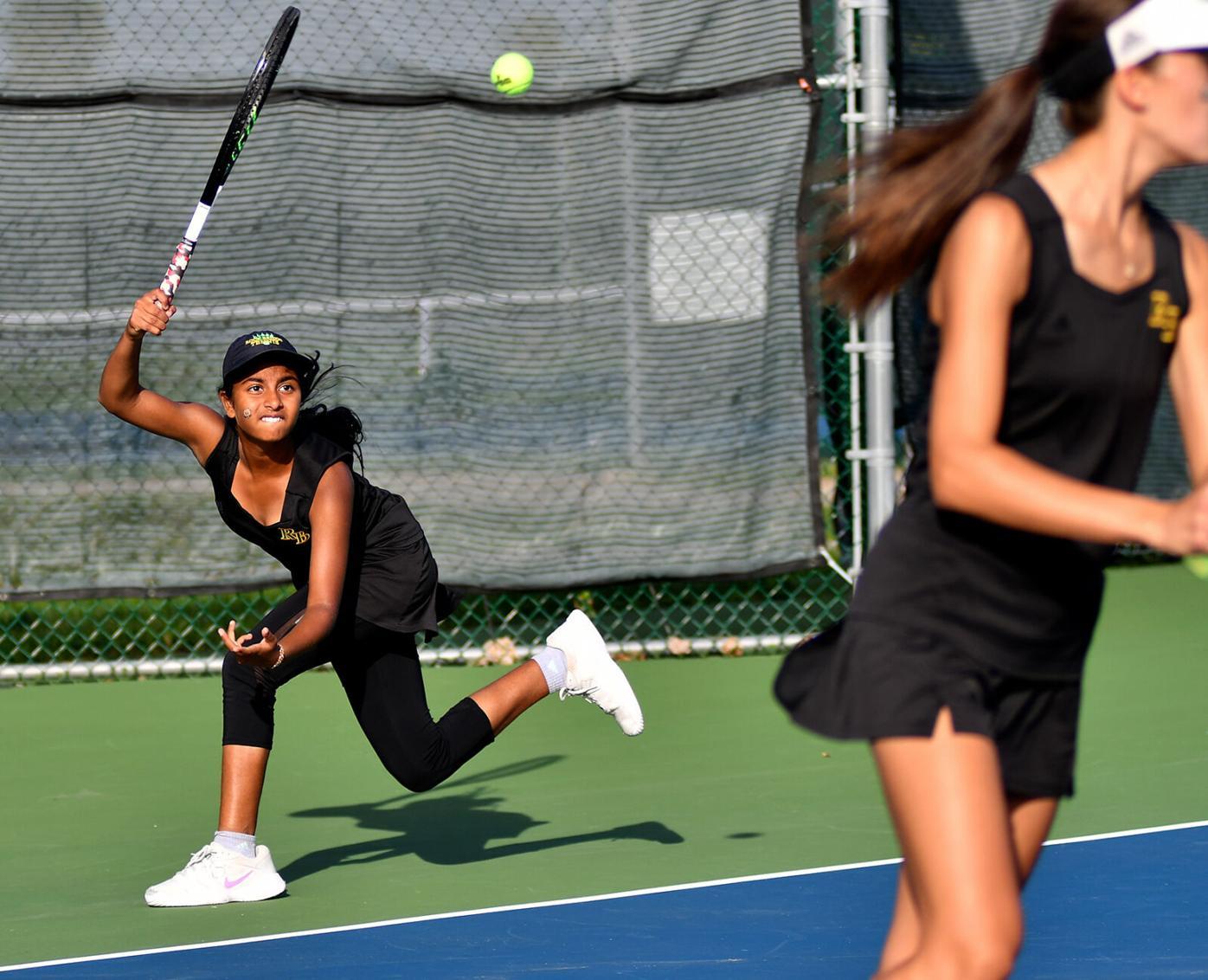 Rock Bridge tennis player Prathyankara Premkumar swings through her forehand