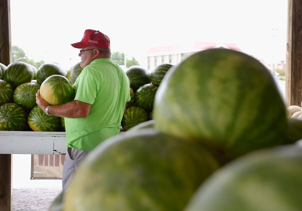 Pete Wimberley carries a watermelon