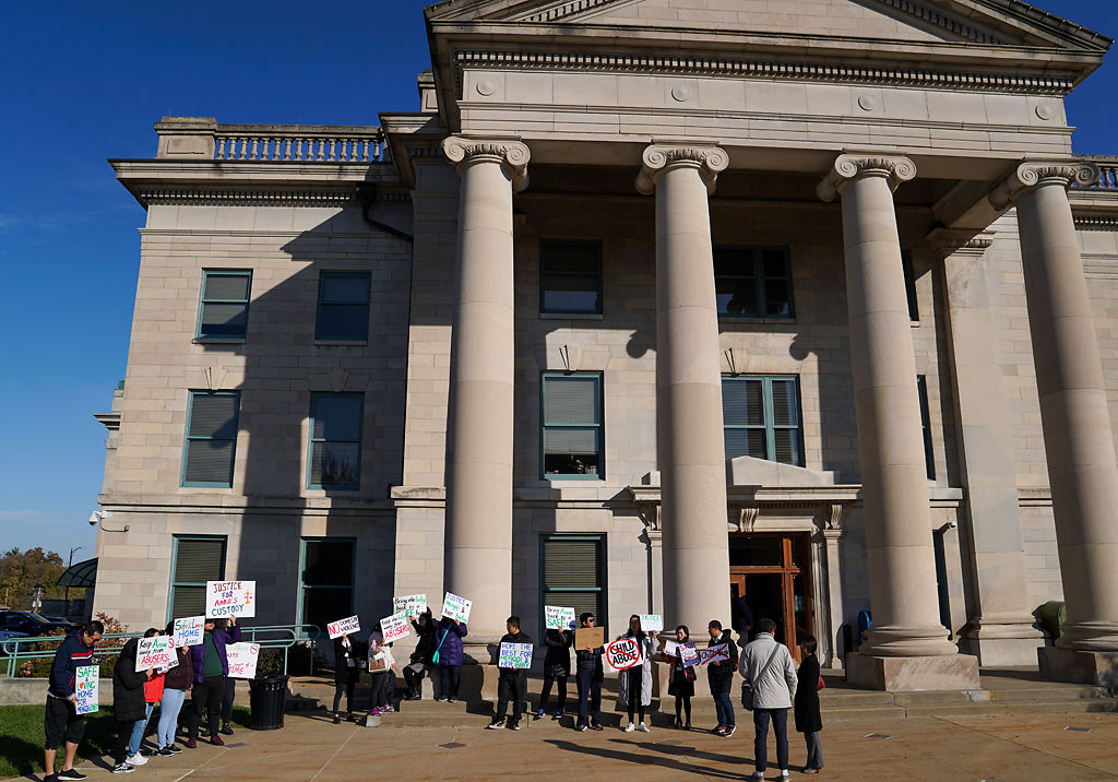 Mengqi's friends and supporters gather in front of the Boone County Courthouse