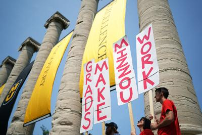 The Coalition of Graduate Workers gathers at the MU columns
