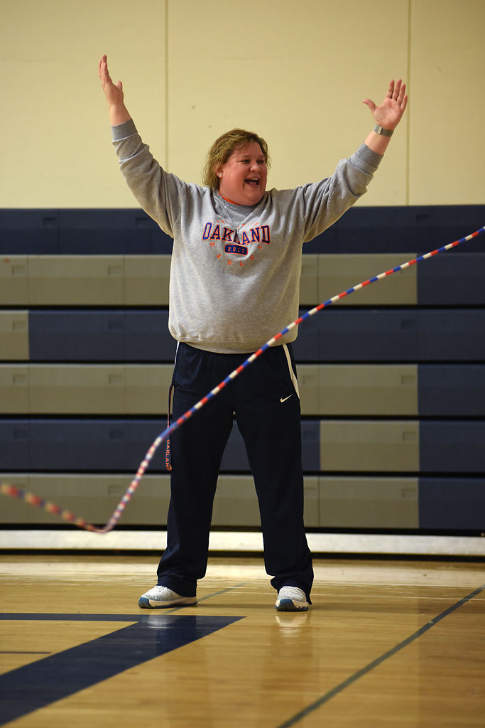 Jen Caine plays in a round of jump rope