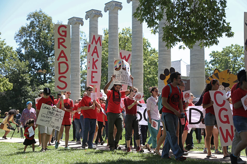 MU graduate students start their march from the MU Columns to Traditions Plaza