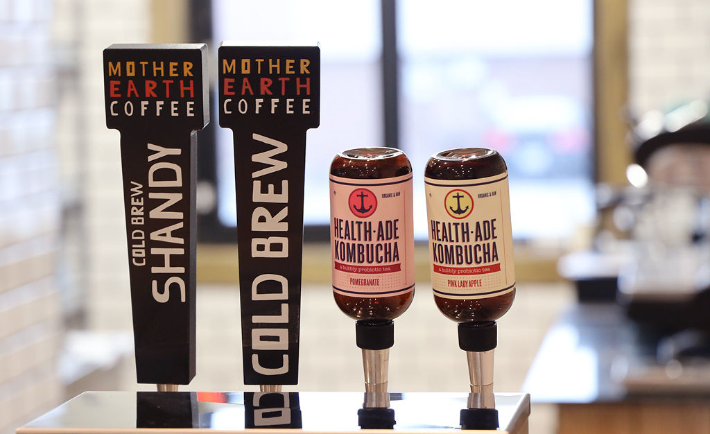 Drink dispensers of coffee and Kombucha sit on a counter