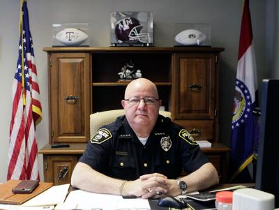 Chief Ken Burton sits at his desk