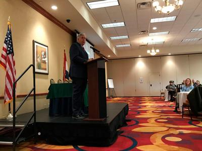 Missouri Governor Mike Parson speaks about conservation to a room filled with people at the 2018 Missouri Conservation Partners Roundtable