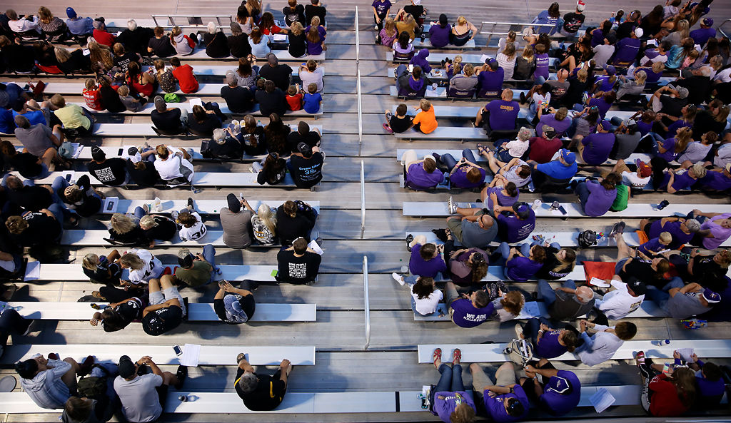 A crowd of Hallsville supporters, right, sit adjacent to supporters of Centralia and Chillicothe High Schools