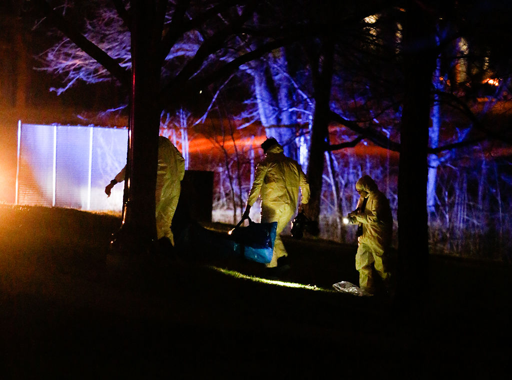 Hazmat-suit clad first responders carry out an investigation
