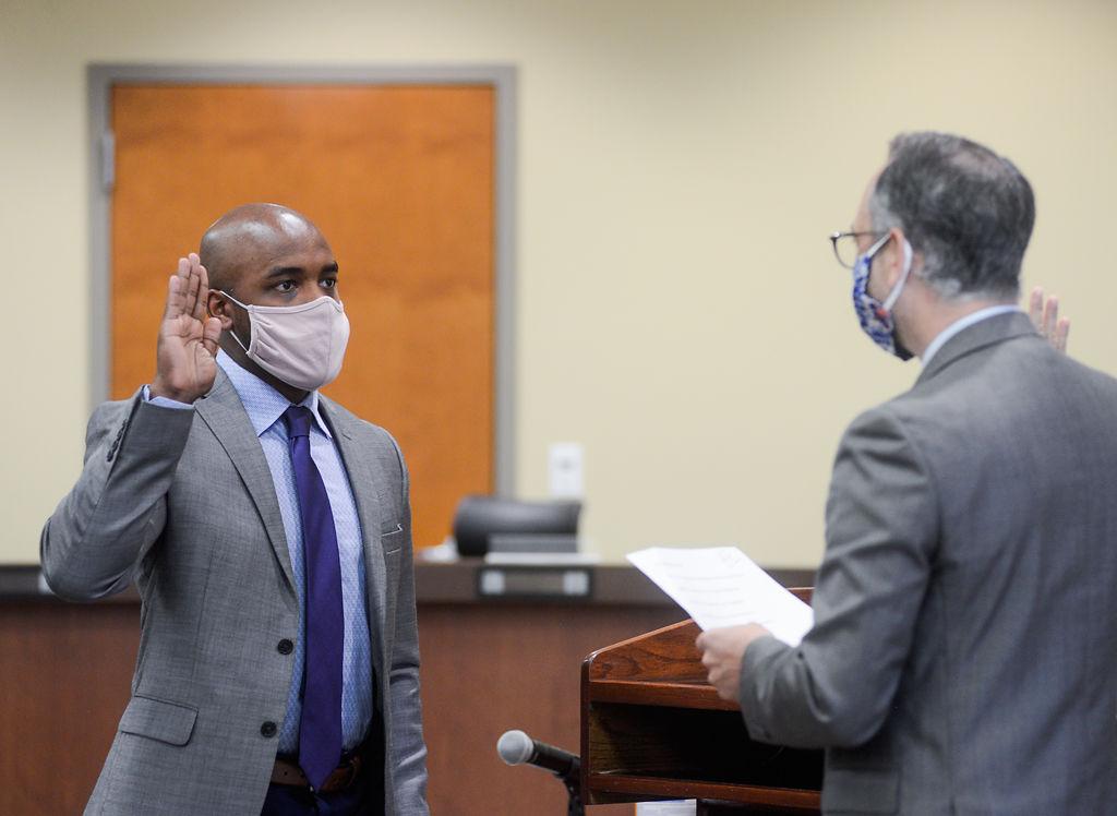 David Seamon, left, is sworn in by Columbia Public Schools Superintendent Peter Stiepleman