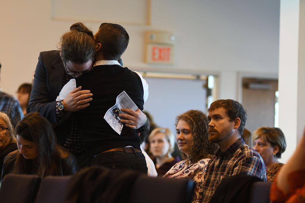 Joel Flynn, left, is hugged by Jon Freeland Jr.