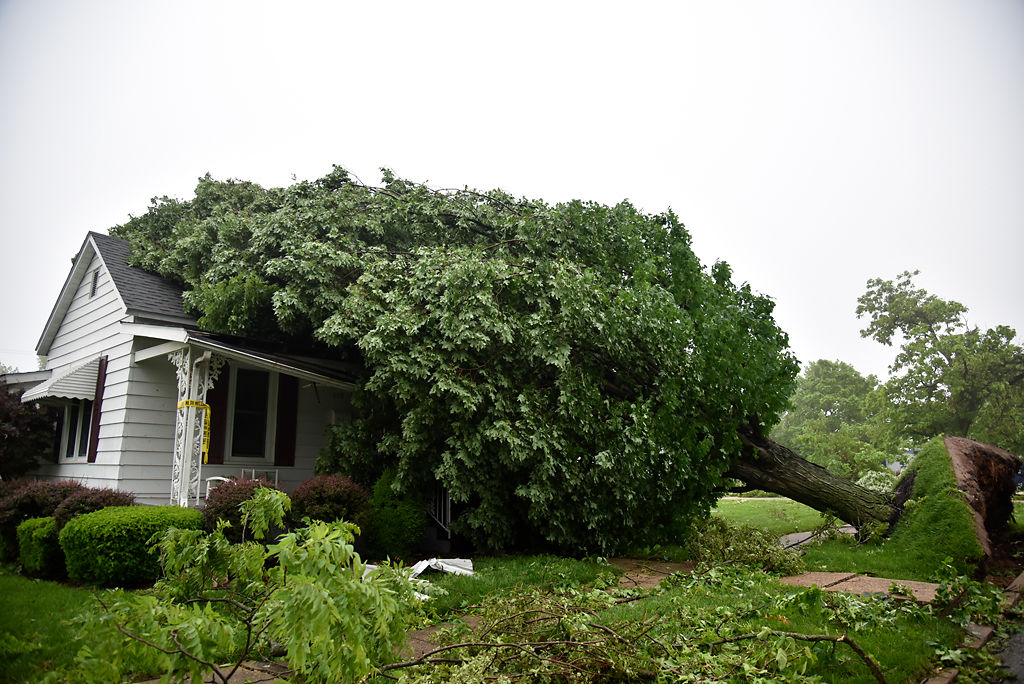 An uprooted tree fell onto a home in Eldon, Missouri
