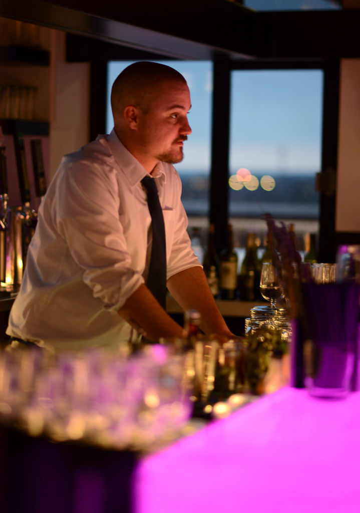 Jordan Hagen talks with customers at Pressed rooftop bar