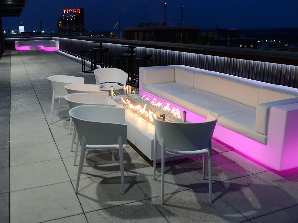 A seating area overlooks the Columbia cityscape at Pressed