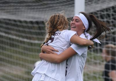 Anya Castelli and Peyton Lane celebrate after Castelli scores Stephens' second goal