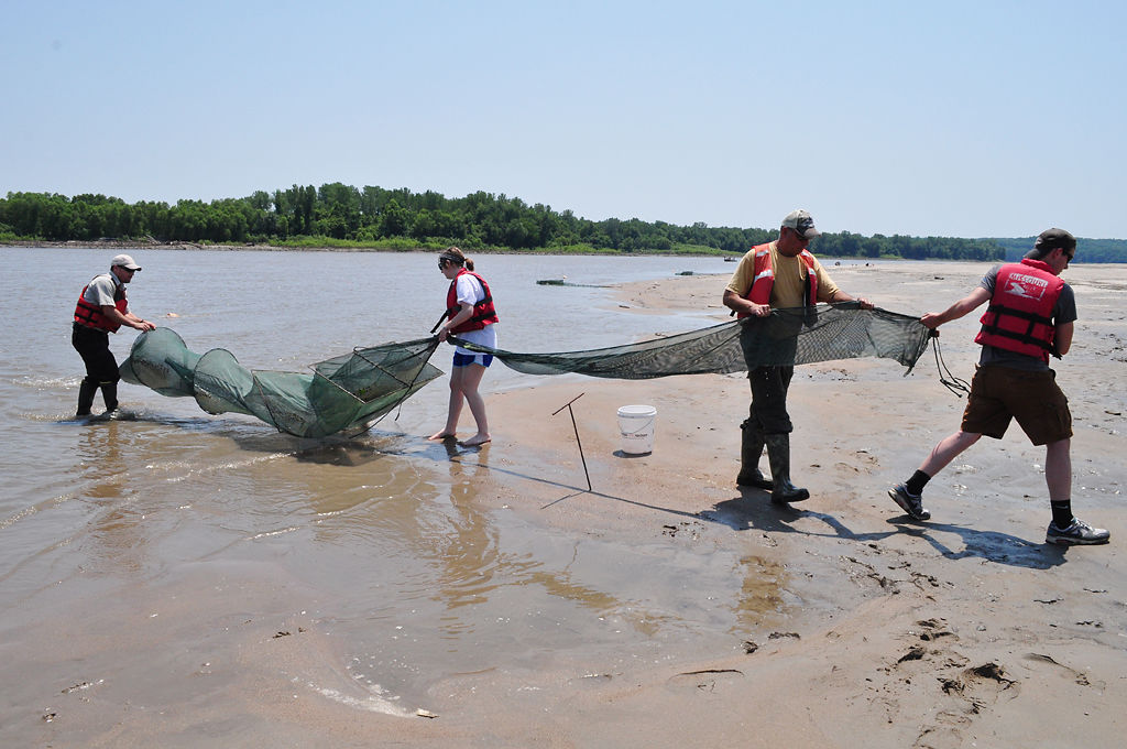 Students and volunteers sample water at Airplane Island