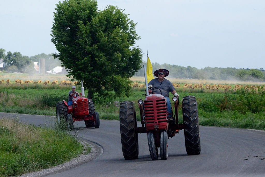 Jerry Forsee, front, drives his tractor back into town