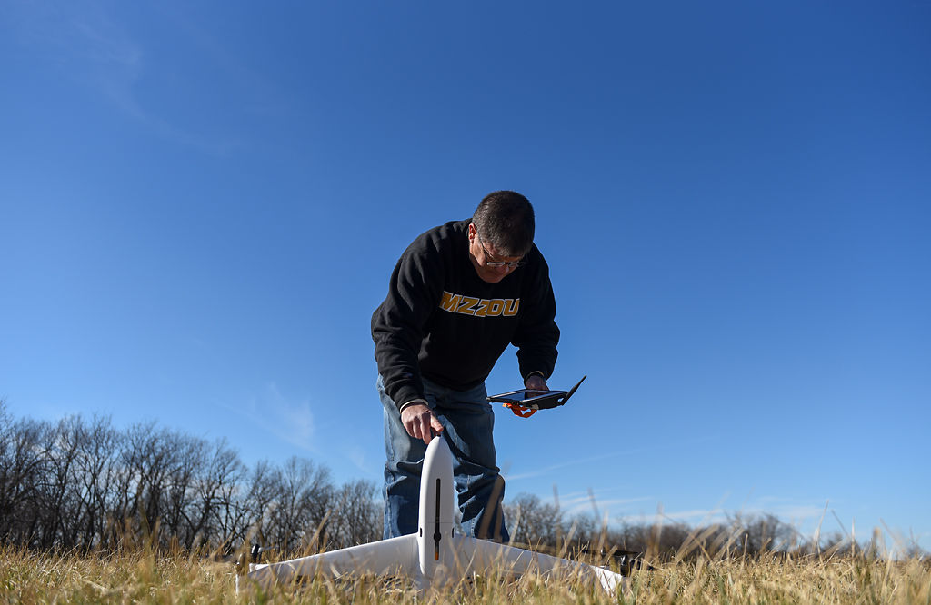 Kent Shannon prepares one of his drones for demonstration