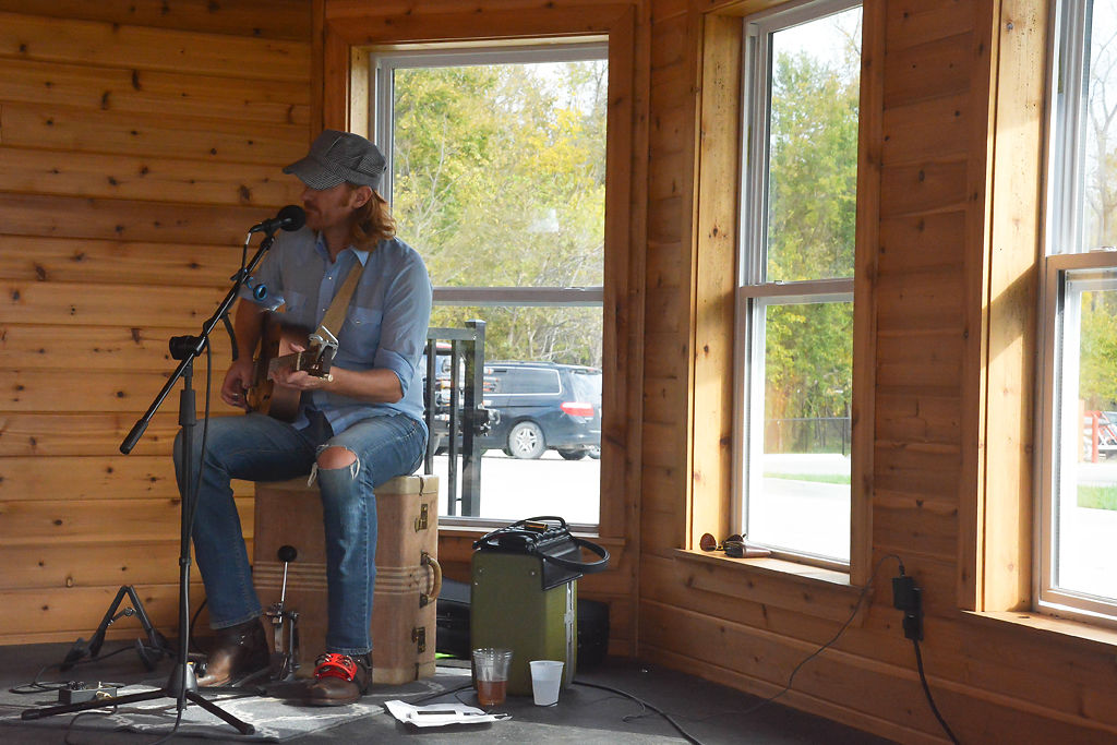 Chris Holm plays folk tunes for visitors