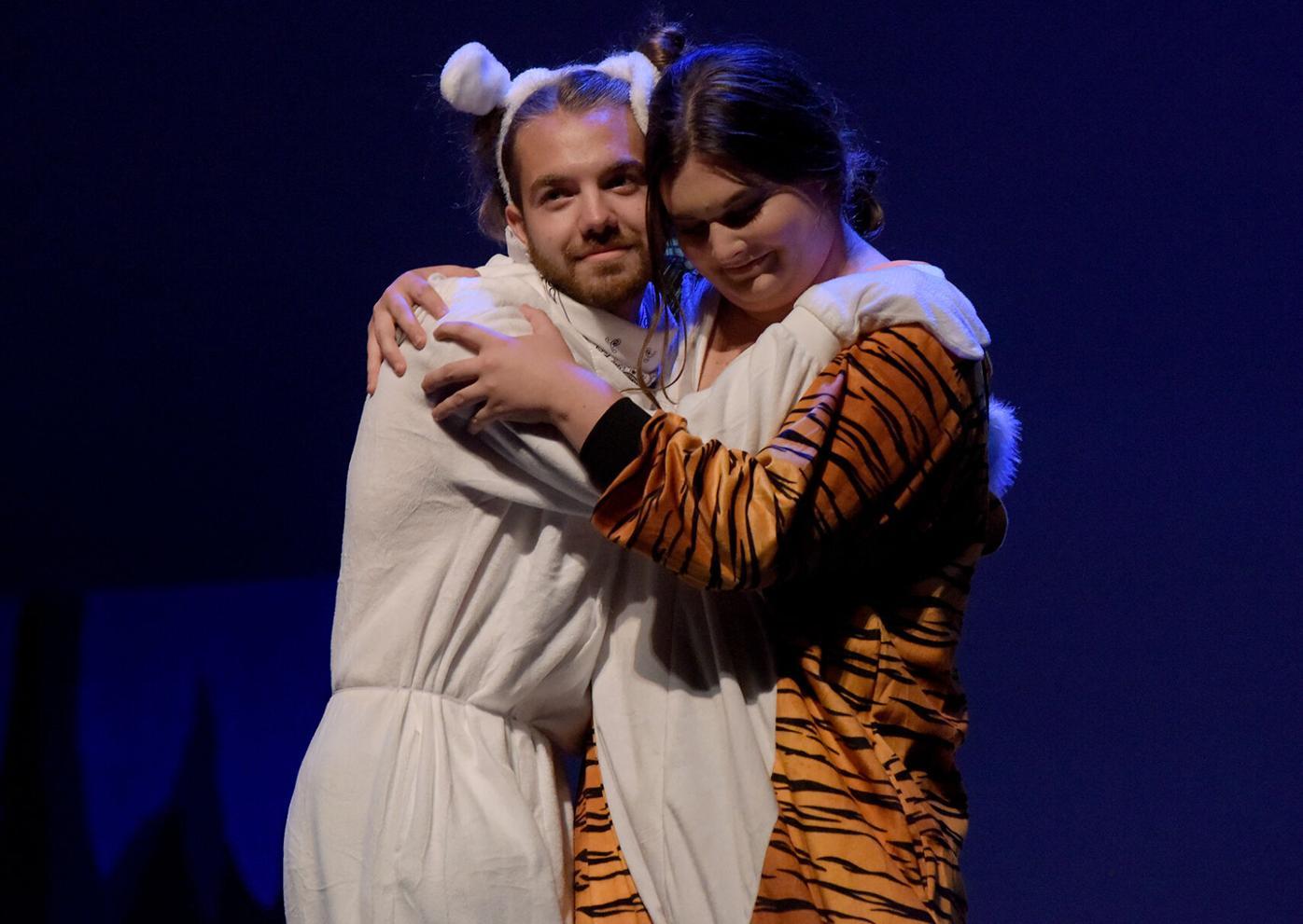Joe Roberts, left, embraces Kathryn Merck as she performs as Truman (copy)