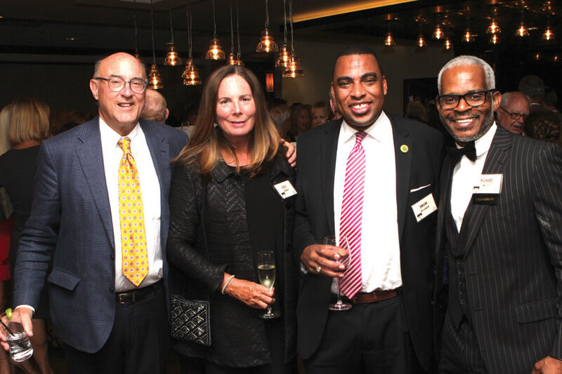 Ross and Leslie Wishnick, Princeton Councilman Dwaine Williamson, and exoneree Richard Miles