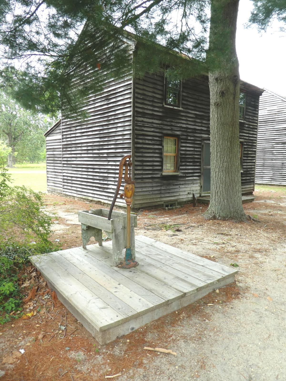 A Village House and Water Pump.JPG