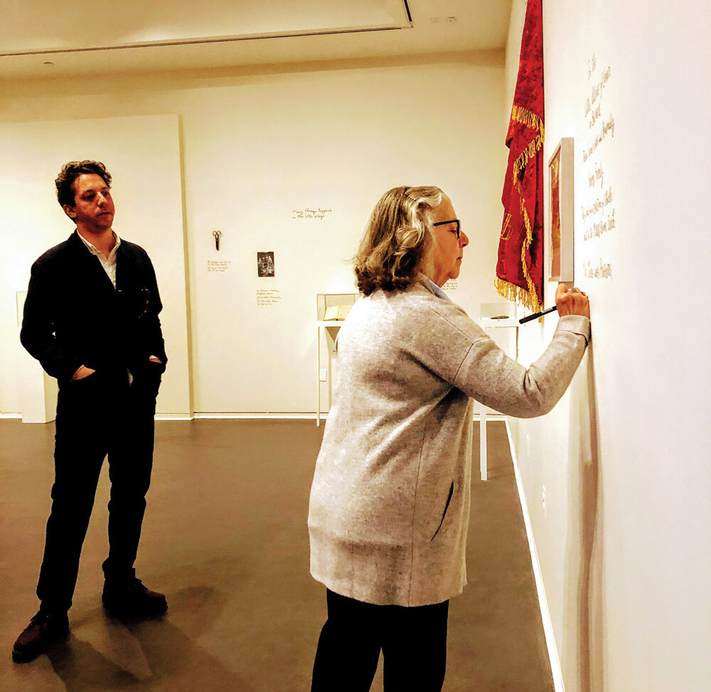 Alex Kalman watches as Maira Kalman finishes writing the text for their exhibition at the National Museum of American Jewish Heritage in Philadelphia